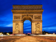 Arc de Triomphe at night, Paris, France. Arc de Triomphe, Paris, France at night. View from Avenue des Champs-Elysees Royalty Free Stock Images