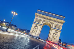 Arc de Triomphe at night. Stock Photo