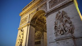 Arc de Triomphe night. PARIS, FRANCE - JULY 2, 2017: Tourists under Arch of triumph at blue hour evening. Arc de Triomphe at the western end of the Champs stock video footage