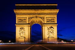 Arc de Triomphe at night, Paris, France. Arc de Triomphe, Paris, France at night. View from Avenue des Champs-Elysees Royalty Free Stock Photo