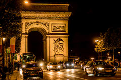 Arc de Triomphe at Night. Street photograph of the Arc de Triomphe at Night Stock Photos