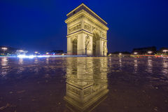 Arc de Triomphe at night. Night time in Arc de Triomphe with pool reflection Stock Images