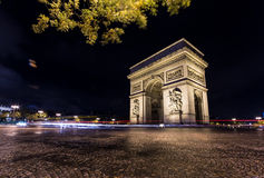 Arc de triomphe by night with trafic lights Royalty Free Stock Photo