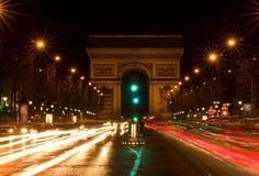 Arc de Triomphe och Champs-Elysees aveny Fotografering för Bildbyråer