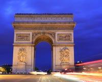 Arc de Triomphe på skymning, Paris Fotografering för Bildbyråer
