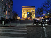 Arc de Triomphe Paris. Arc de Triomphe in Paris, photographed just after sunset with a beautiful dark blue sky Stock Photo
