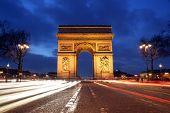 Arc de Triomphe, Paris. Arc de Triomphe and Champs-Elysees Avenue at night Stock Photography