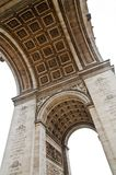 Arc de Triomphe in Paris. Underneath the historic Arc de Triomphe in Paris Royalty Free Stock Image