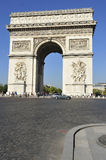 Arc de Triomphe in Paris. The famous landmark, Arc de Triomphe in Paris, France under the blue sky Stock Photos