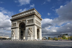 Arc de Triomphe, Paris. Arc de Triomphe in Paris France with dramatic clouds and blue sky Royalty Free Stock Image
