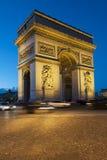 Arc de Triomphe - Paris. Paris, Arc de Triomphe by night with strips of vehicles Royalty Free Stock Images
