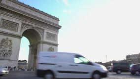 Arc de Triomphe in Paris, active traffic near famous architecture monument. Stock footage stock video footage