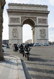 The Arc de Triomphe. PARIS - APRIL 07: Traffic in front of the Arc de Triomphe on August 07, 2013 in Paris, France Royalty Free Stock Image