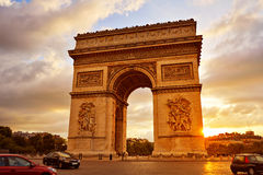Arc de Triomphe in Paris Arch of Triumph. Sunset at France Royalty Free Stock Photo
