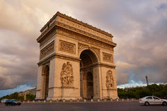 Arc de Triomphe in Paris Arch of Triumph. Sunset at France Stock Photos