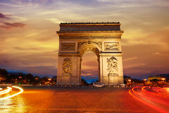 Arc de Triomphe in Paris Arch of Triumph. Sunset at France Royalty Free Stock Photos