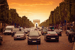 Arc de Triomphe in Paris Arch of Triumph. Traffic sunset at France Stock Photography