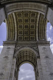 Arc de triomphe Paris architecture. A wide angle view looking up at the world famous Arc de triomphe in Paris, France. You can see the amazing detail in the Royalty Free Stock Images