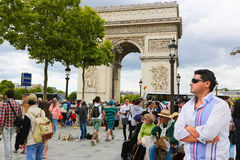 Arc de triomphe - Paris. Aug 22, 2014 Tourists stroll near the Arc de triomphe - Paris - France Stock Image