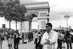 Arc de triomphe - Paris. Aug 22, 2014 Tourists stroll near the Arc de triomphe - Paris - France Royalty Free Stock Image