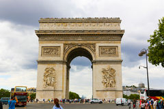 Arc de triomphe - Paris. Aug 22, 2014 Tourists stroll near the Arc de triomphe - Paris - France Stock Images