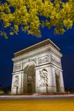 Arc de triomphe in Paris with blue sky at night. Amazing ornamental monument of Arc de Triomphe illuminated in twilight in Paris Royalty Free Stock Photography