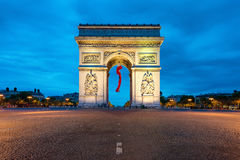Arc de Triomphe Paris and Champs Elysees at Paris, France. Arc de Triomphe Paris and Champs Elysees with a large France flag flying under the arch in Europe Stock Photos