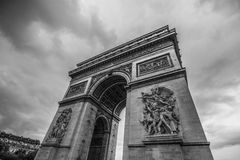 Arc de triomphe Paris city in balck and white. The arc de triomphe in paris at a cloudy day in balck and white Stock Image