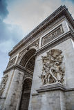 Arc de triomphe Paris city. The arc de triomphe in paris at a cloudy day with the beautiful sculpture Royalty Free Stock Photography