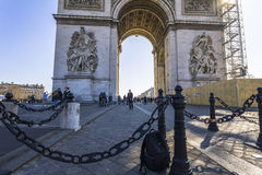 The Arc de Triomphe in Paris at daylight. The Arc de Triomphe in Paris, France at daylight Royalty Free Stock Image