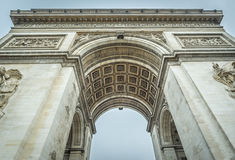 Arc de Triomphe of Paris in details. Arc de Triomphe, famous historical building placed where the Champ Elysees boulevard starts. Picture captured in Paris Royalty Free Stock Images