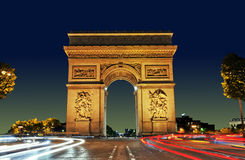 Arc de Triomphe, Paris France. Arc de Triomphe in Paris with beautiful sunset and light streams from cars Royalty Free Stock Photo
