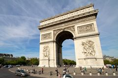 Arc de Triomphe - Paris France. Arc de Triomphe in Paris, France. Shot on a sunny day with many tourists around the area Stock Photography
