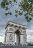 Arc de Triomphe, Paris, France. Arch Triumph road street tree clouds grey Royalty Free Stock Image