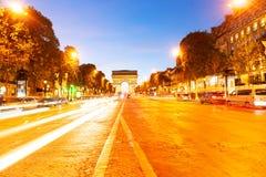 Arc de triomphe, Paris, France. Arc de Triomphe and Champ Elysees illuminated at night, Paris, France, retro toned Stock Image