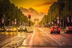 Arc de triomphe, Paris, France. Arc de Triomphe and champ Elysees at sunset, Paris, France, retro toned Royalty Free Stock Photography