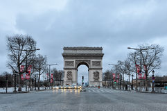 The Arc de Triomphe in Paris. PARIS, FRANCE - CIRCA MARCH 2010: Quiet early Sunday morning on the Champs-Elysées and the Arc de Triomphe Stock Photo
