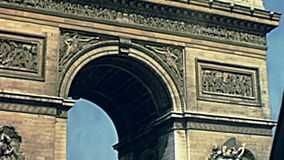 Arc de Triomphe Paris. PARIS, FRANCE - CIRCA 1968: Tourists at Arch of triumph. Arc de Triomphe at the western end of the Champs Elysees and at the center of stock video footage