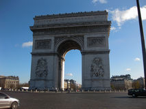 Arc de Triomphe, Paris. Paris, France - December 2011 : The arch was commissioned by Napoleon in 1806 as a tribute to the French army. Located in the centre of Stock Photos