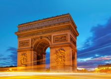 Arc de Triomphe in Paris, France at Dusk. With light-trail from passing vehicles Stock Photography
