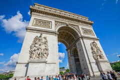 Arc de Triomphe Paris. PARIS, FRANCE - JULY 2, 2017: Tourists under Arch of triumph. Arc de Triomphe at the western end of the Champs Elysees and at the center Stock Images