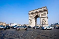 The Arc de Triomphe, Paris, France. PARIS - MARCH 20: View of the Arc de Triomphe and and the traffic on the Arc de Triomphe roundabout on March 20, 2015 in Royalty Free Stock Photo