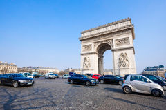 The Arc de Triomphe, Paris, France. PARIS - MARCH 20: View of the Arc de Triomphe and and the traffic on the Arc de Triomphe roundabout on March 20, 2015 in Stock Photography