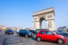 The Arc de Triomphe, Paris, France. PARIS - MARCH 20: View of the Arc de Triomphe and and the traffic on the Arc de Triomphe roundabout on March 20, 2015 in Royalty Free Stock Photos