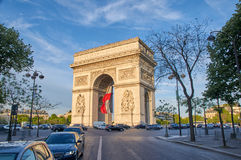 Arc de Triomphe. PARIS, FRANCE - MAY 10, 2017 : Arc de Triomphe with french flag in the evening. Triumphal Arch is one of the most famous monuments in Paris Stock Photography
