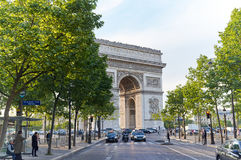 Arc de Triomphe. PARIS, FRANCE - MAY 10, 2017 : Arc de Triomphe with french flag in the evening. Triumphal Arch is one of the most famous monuments in Paris Stock Image
