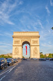 Arc de Triomphe. PARIS, FRANCE - MAY 10, 2017 : Arc de Triomphe with french flag in the evening. Triumphal Arch is one of the most famous monuments in Paris Royalty Free Stock Image