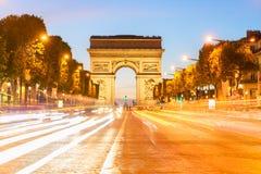 Arc de triomphe, Paris, France. Arc de Triomphe at night with light trails, Paris, France Stock Image