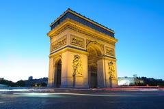 Arc de Triomphe in Paris , France. Arc de Triomphe at night with light trails Stock Photos