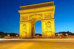 Arc de Triomphe in Paris , France. Arc de Triomphe at night with light trails Stock Photo